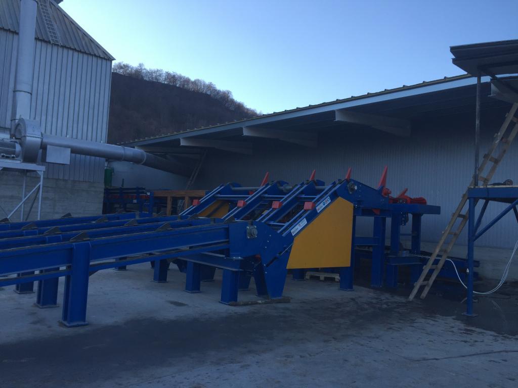 Caricatori per tronchi con vasca di carico idraulica pneumatica